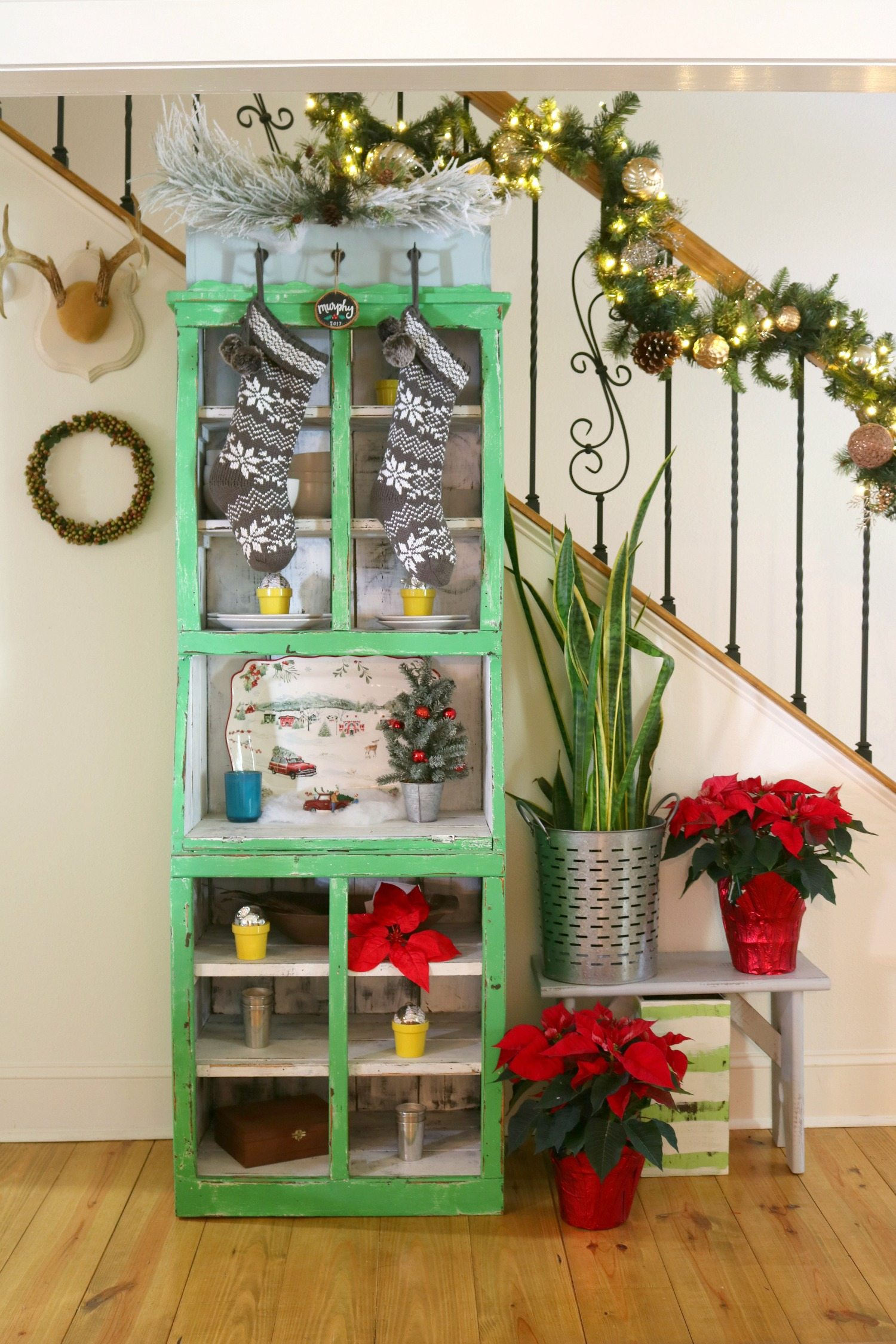 Green cabinet with Christmas decor