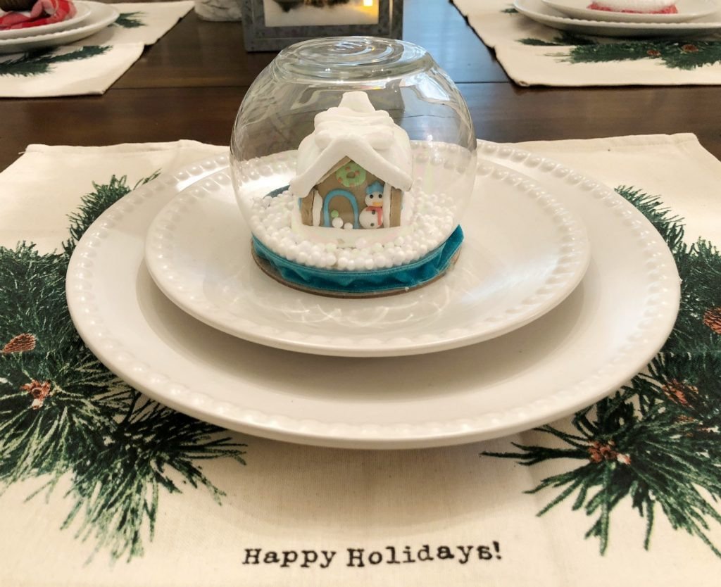 Mini snow globe trimmed in blue velvet