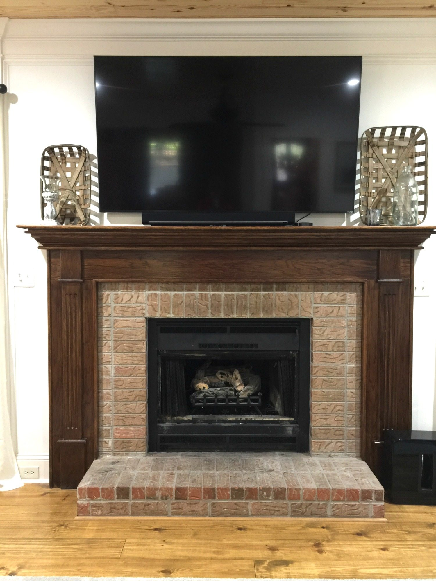 How to paint your fireplace brick mantel refresh restyle before painting how to paint brick and wood on your fireplace solutioingenieria Image collections