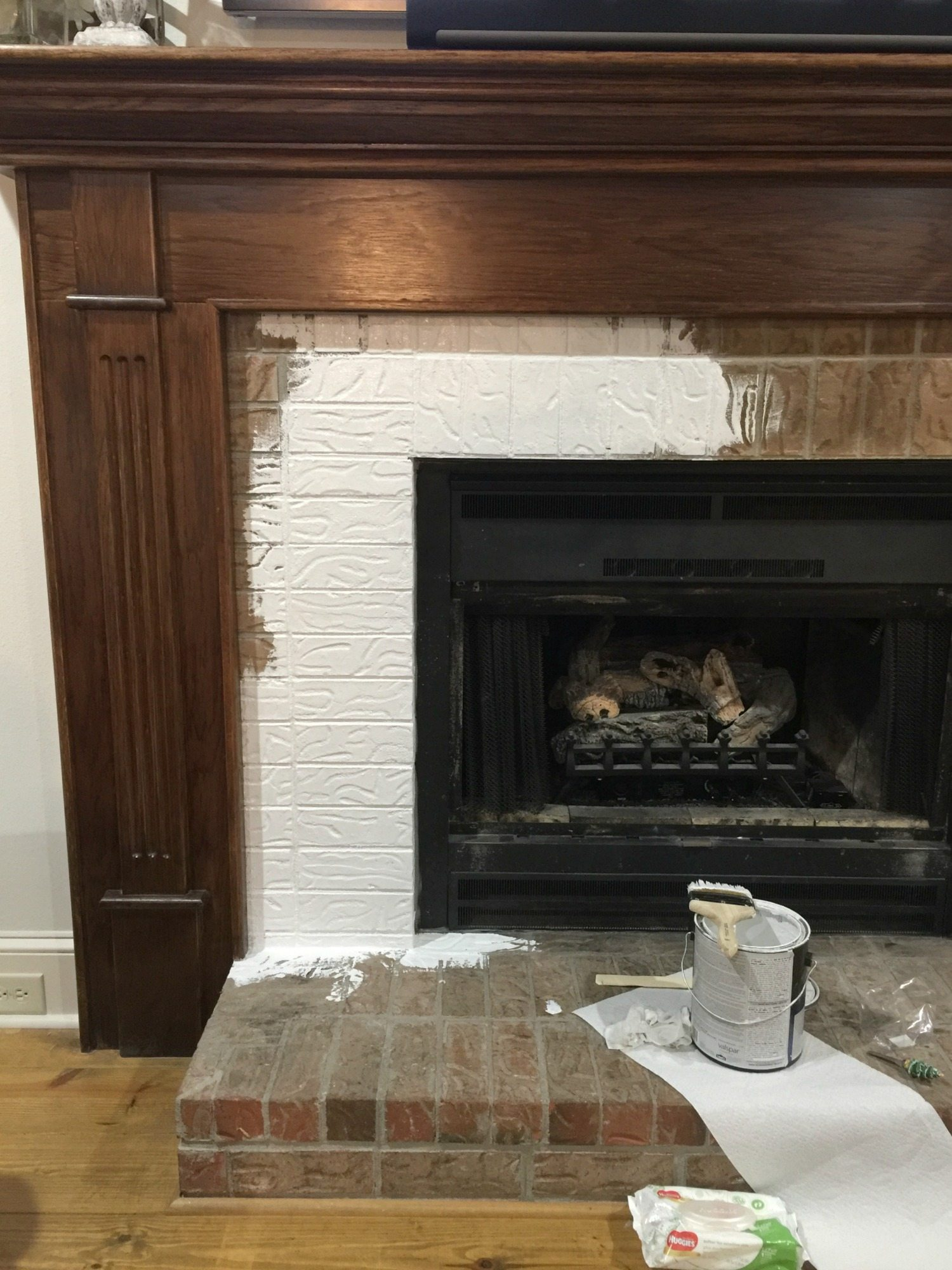 Prime before painting - painting brick on a fireplace