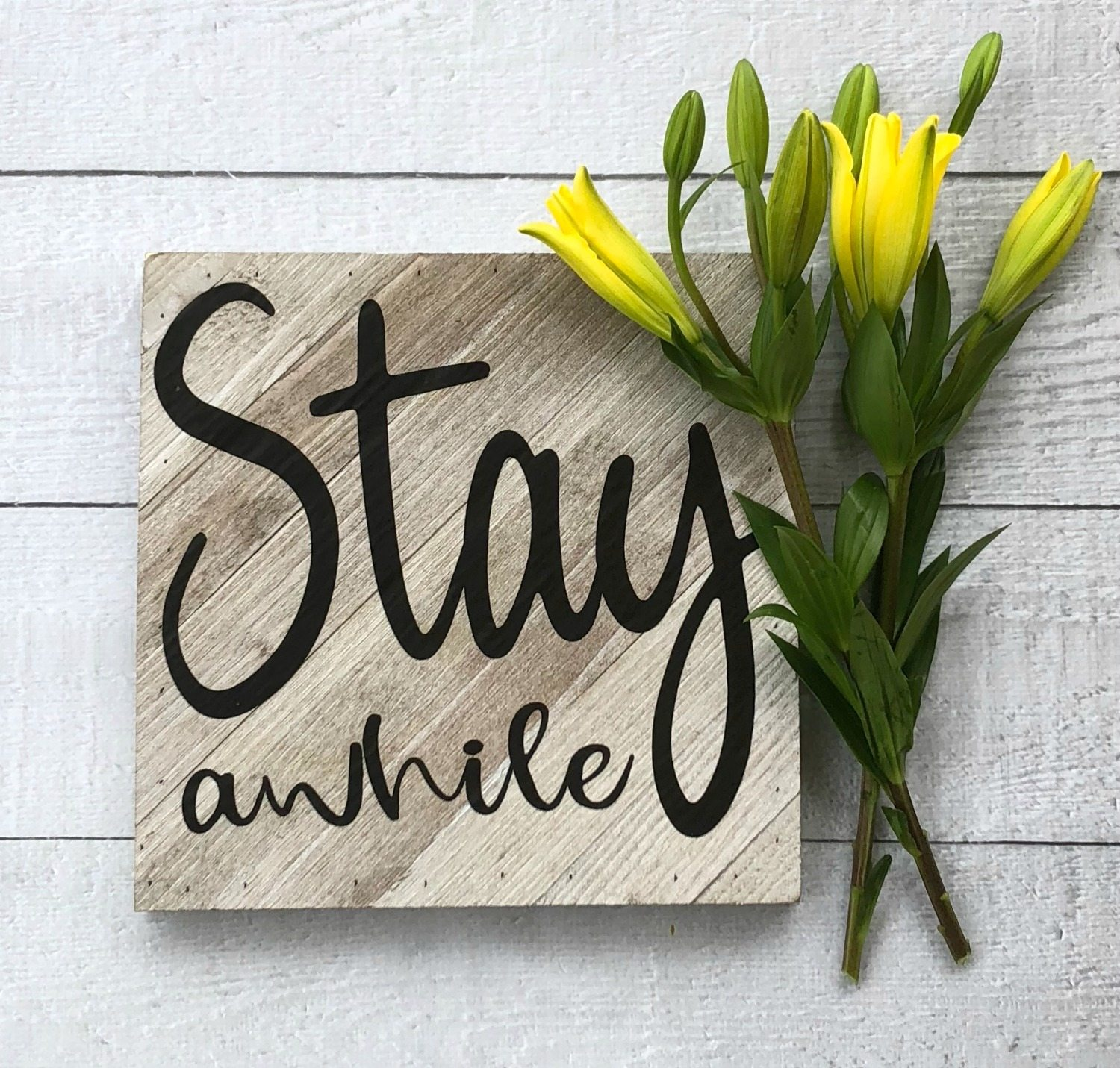 Make this Stay A While farmhouse sign, it's easy with a vinyl cutting machine. Perfect for farmhouse style.
