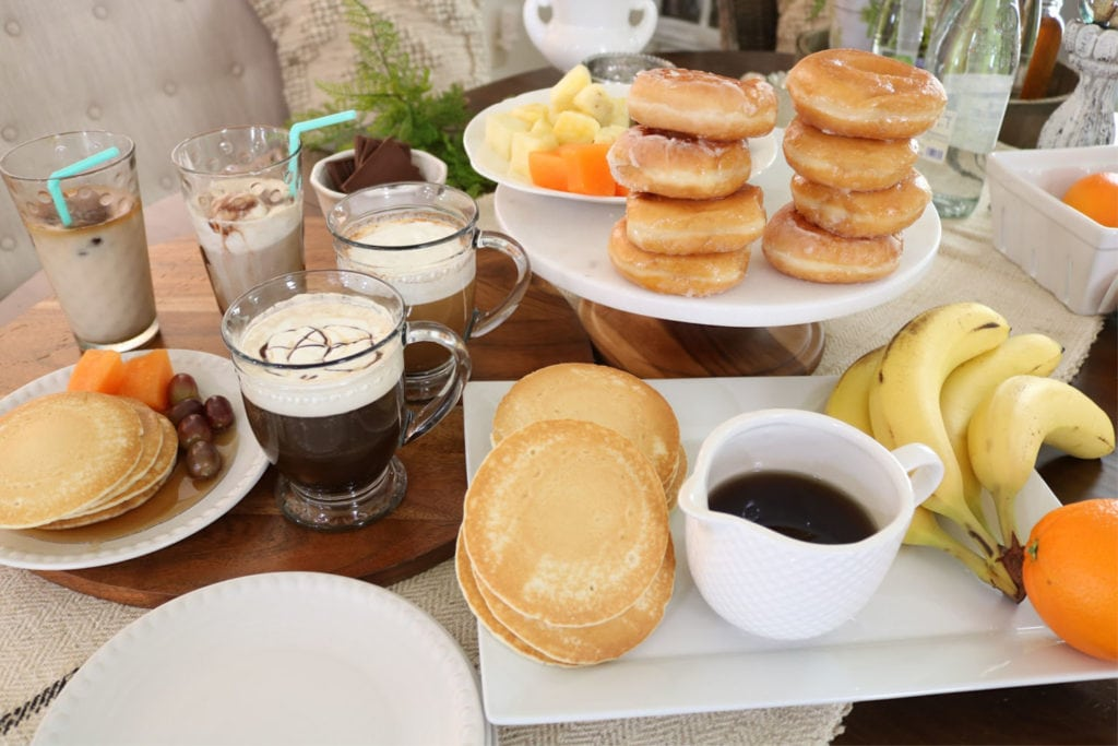 Coffee donuts pancakes and fruit bar