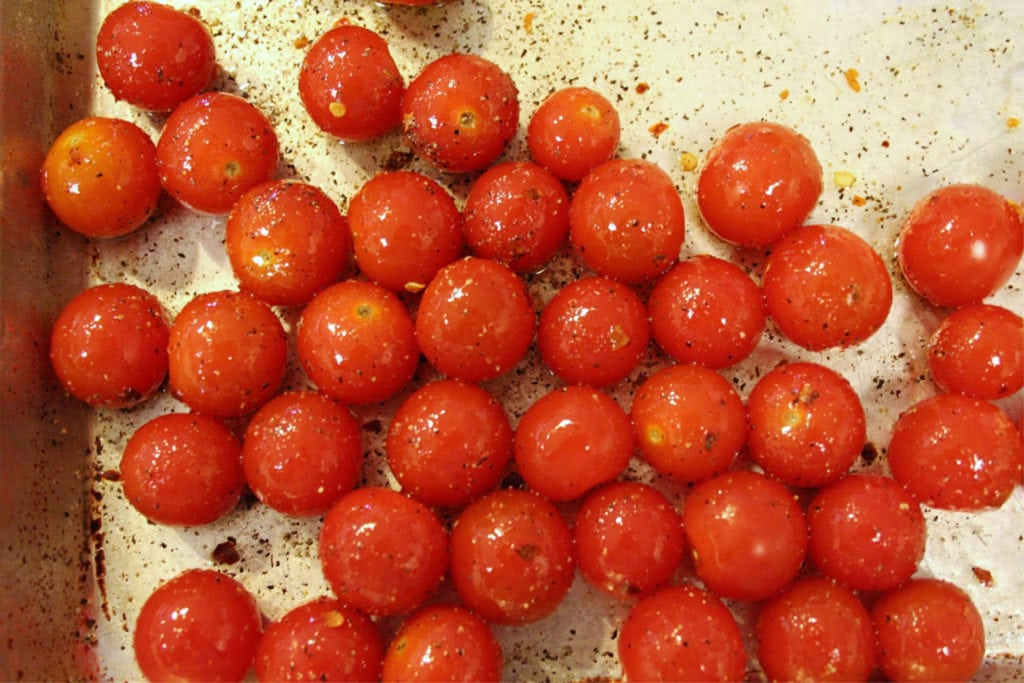 Toss tomatoes in oil spices