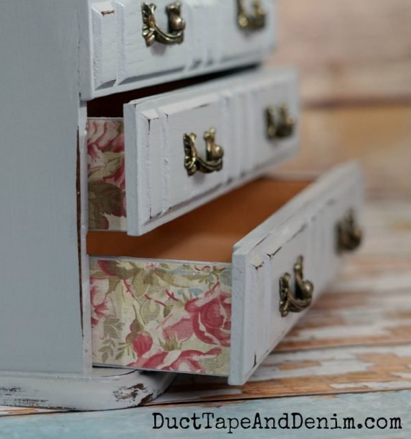 Close-up-floral-scrapbook-paper-on-sides-of-drawers-DuctTapeAndDenim.com_-600x640