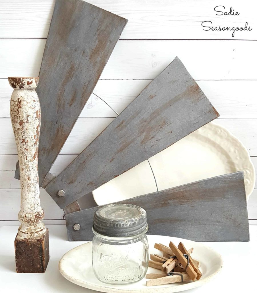 100+ Thrift Store Makeovers - Ceiling_fan_blades_to_be_repurposed_as_DIY_salvaged_windmill_farmhouse_style_decor_by_Sadie_Seasongoods