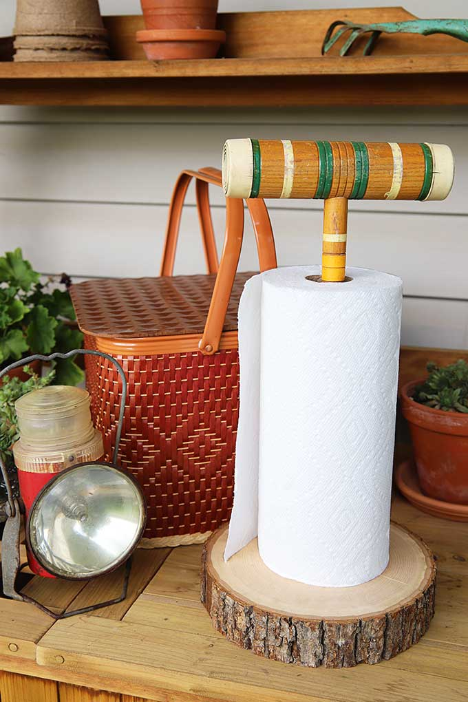 100+ Thrift Store Makeovers - croquet-mallet-paper-towel-holder