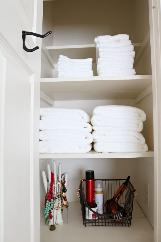 BHG towel closet update - fresh white towels and wire basket.