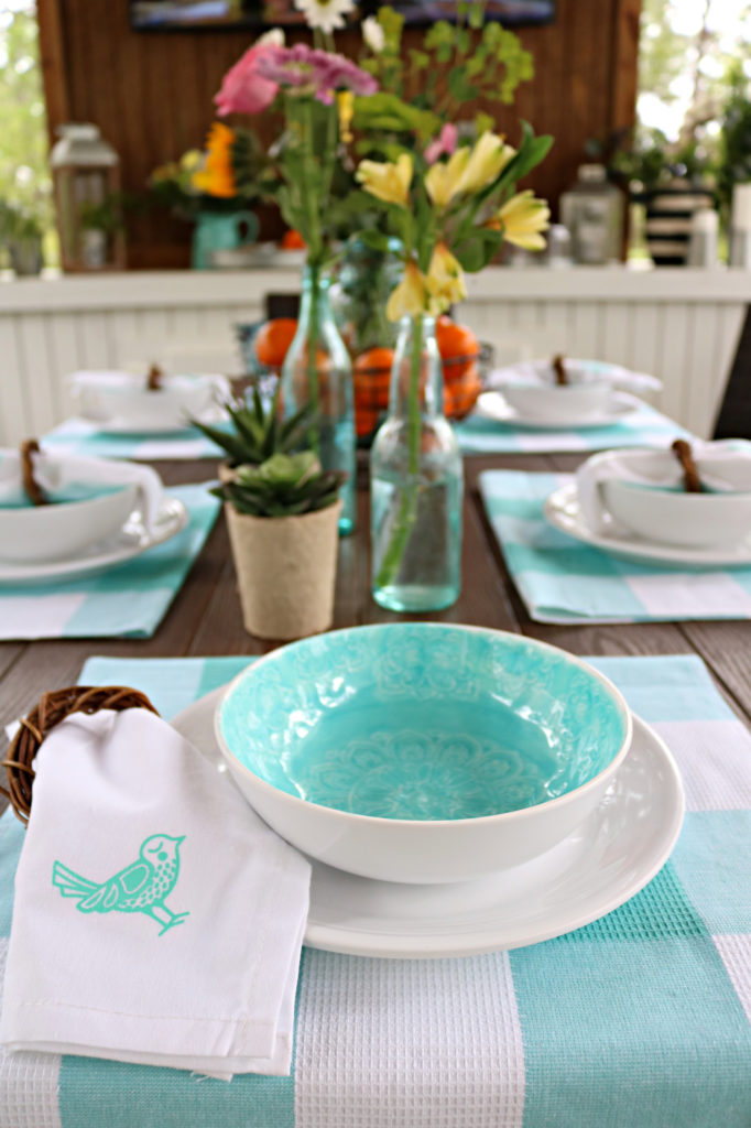 Melamine white dishes with teal bowl.