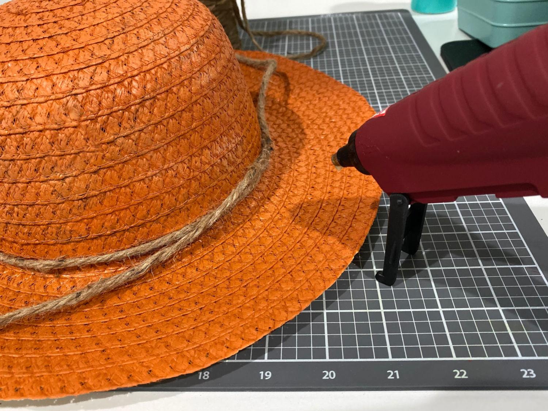 Glue twine on hat